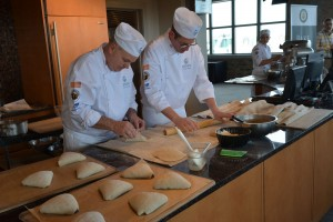 Jory and François rolling out flaps to shape the triangular Roasted Potato Bread