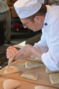François Brandt piping the beer topping on the Roasted Potato Bread, to be dusted with rye flour after spreading